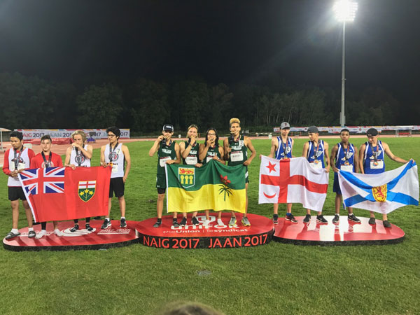Bauman (centre, far right) with his teammates at the awards ceremony for the U16 4x400 relay. Bauman's made friends with his competitors and hopes to stay in touch with them until he competes again at the next NAIG.