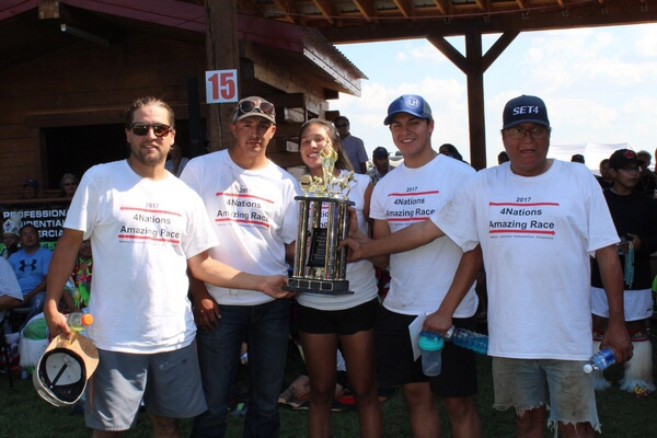 Team Bear received a trophy and a monetary prize for placing first in the 4 Nations Amazing Race competition. (L-R: Chance Bear, Kane Bear, Lenasia Ned, Ethan Bear and Paul Bear).