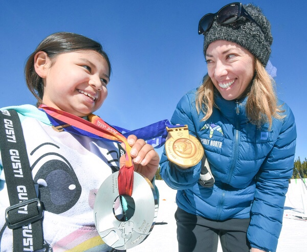 Beckie Scott (right) and a student participating in Spirit North ski days