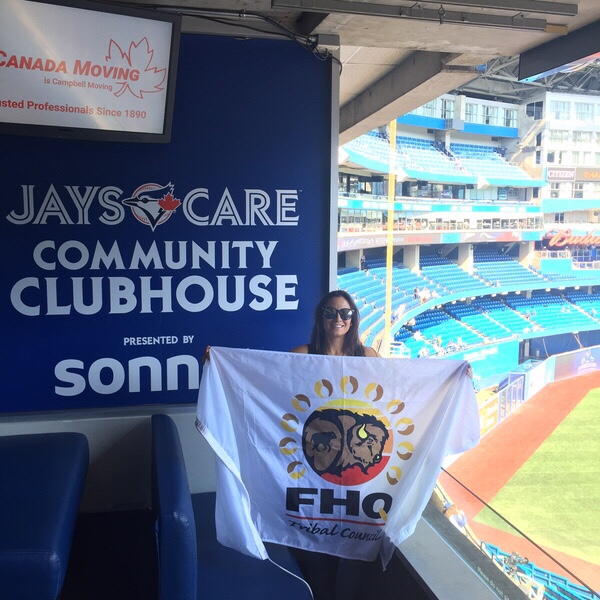 Tara Griffith with FHQ banner at the Jays home field in Toronto.